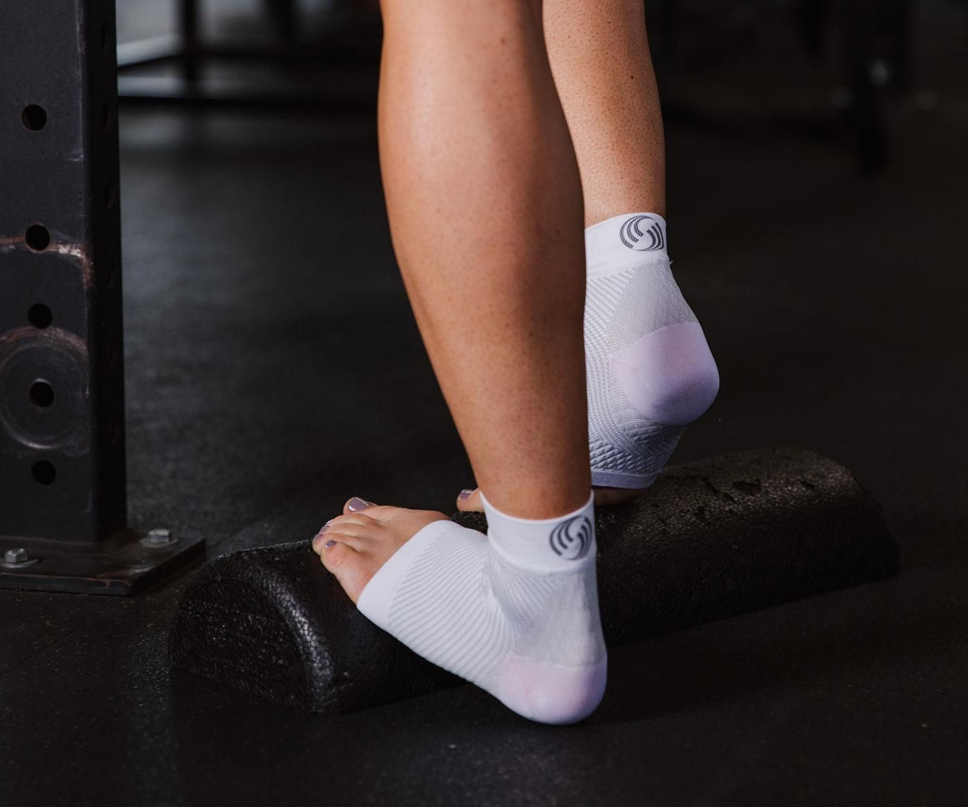 A person exercising their feet whit compression wear